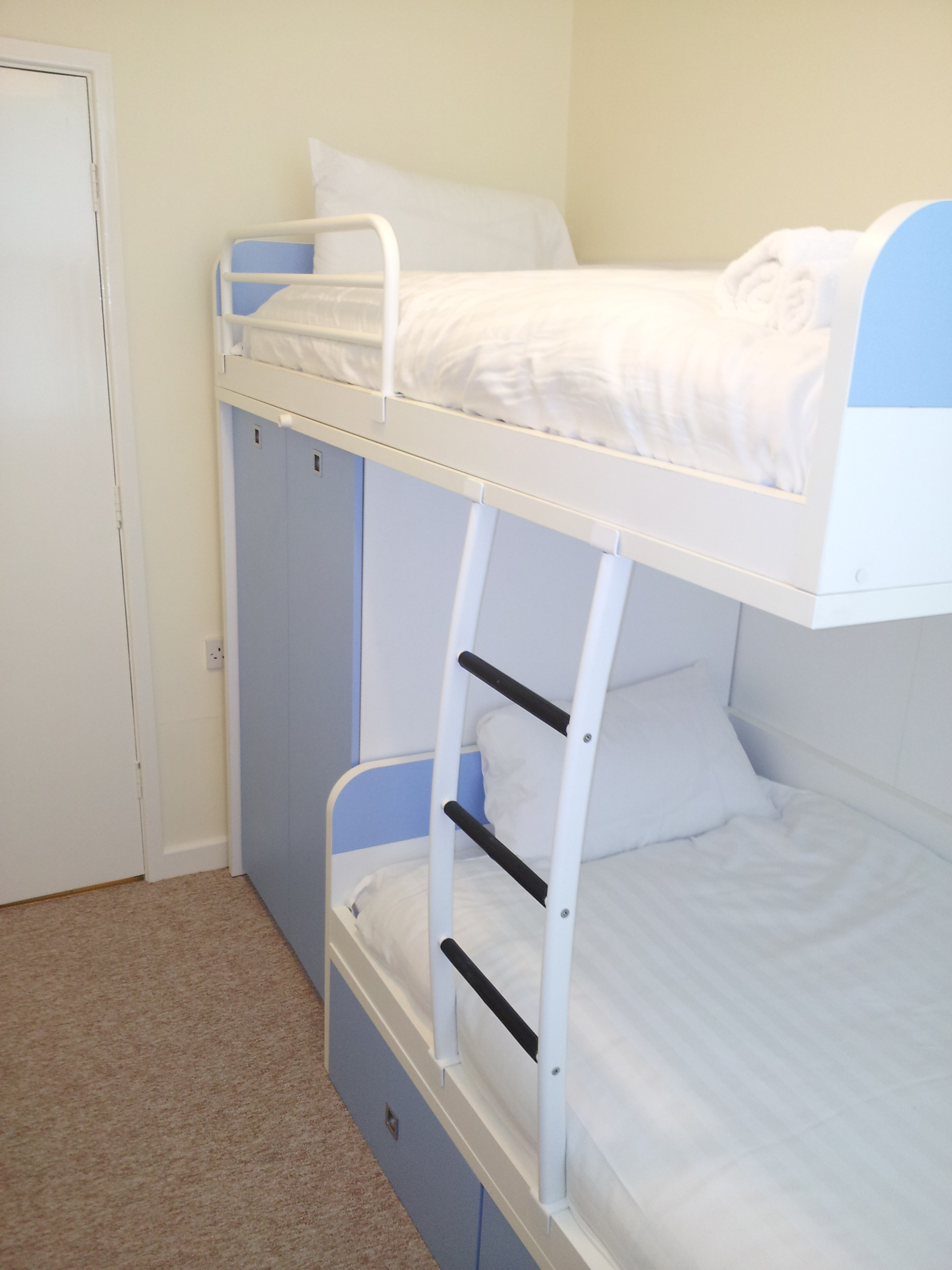 The second bedroom has a comfortable bunk bed with storage.